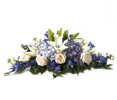 PlantShed | Ocean Breeze | Flower Delivery NYC | Beautiful blue floral centerpiece of white oriental lilies, roses, hydrangeas and delphinium. Perfect for any occasion.