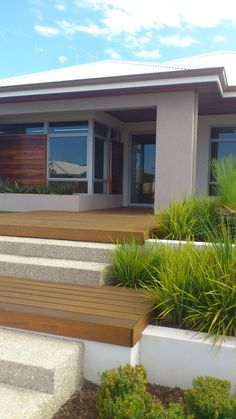A contemporary landscape design tying in the decked verandah Contemporary Landscape, Landscape Design, Garage Doors, Homes, Outdoor Decor, Home Decor, Houses, Decoration Home, Room Decor