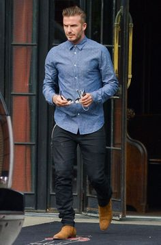Soccer star David Beckham tries to hide his face as he is seen leaving The Bowery Hotel in New York City, New York on September 10, 2014. David said in a recent interview that his wife Victoria Beckham is terrified with him riding a motorcycle but she still lets him ride. Don't worry David your wife was spotted out in London today so ride away on your motorcycle.