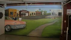 Mural of a 50's town painted on a garage door.