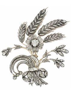 A GEORGIAN DIAMOND AIGRETTE, CIRCA 1800. Modelled as a spray of wheat sheaves and various flowers, set…