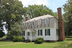 The Moore House, York Co., Virginia, is best known as the site where the Articles of Capitulation following the 1781 Battle of Yorktown were negotiated & drafted. The home was erected on  land originally granted to the Crown Gov.of Virginia, John Harvey in the 1630s. Lawrence Smith II later built the Moore House & the home stayed in the family until 1754 when his son, Robert, sold it to his brother-in-law Augustine Moore to avoid financial woes.