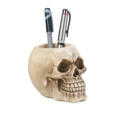 by Dragon Crest Decorate your desk with this detailed skull pen holder and it will hold your writing utensils for you while giving you a toothy grin. This fun desk accessory is made from polyresin and features cool details that will delight you.  allgooddecor.com  #allgooddecor #furniture #accents #decor #gifts #decorations #lighting #candles #mirrors #figurines #fountains #outdoor #toys