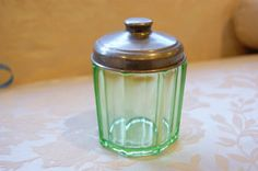 green depression glass jar w/ silver lid