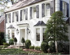 Several different periods fall under this category but when we think of a classic colonial that usually includes a symmetrical facade with flared hip roofs, small recessed entries, and dormers. Colonials are often trimmed in keystones and/or shutters flanking the windows.