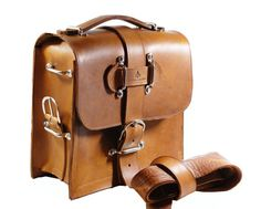 Rugged Leather Camera Bag - Indiana Jones Satchel Messenger Bag Tan Leather  The most badass camera bag you'll ever own: the Kirkaldy Satchel is like that cool cousin who rode motorcycles and played the guitar, and showed up only a few times a year to take you for a spin and buy you beer when you were underage. It's ruggedly handsome and overprotective – your camera will be guarded and protected while you're on your adventures – be they close to home or in the great unknown.  Made in a…