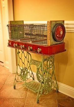 Repurposed Red Rider Wagon Sewing Machine Iron Base Wire Gym Baskets Yardstick Table of Recycled Found Industrial Objects.