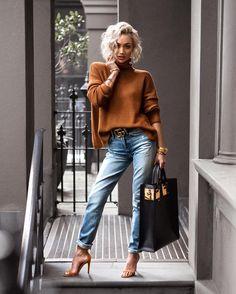 Sweater kinda weather @loversfriendsla knit & @grlfrnd_denim jeans via @revolve // @gucci belt // @sophie_hulme tote // @mode_collective heels ✨