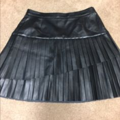 Leather lined pleaded skirt NWT. Nine West pleased skirt. Has linning, shown in picture. Zips on the side. Size 6 Nine West Skirts Mini