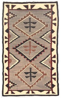 """1920, Beautiful and rare dragonfly design rug with heather field, this is the rug featured on page 92 of Dockstader's famous book, """"Weaving Arts of the North American Indians."""" Very good condition overall with minor repairs, includes a copy of the 72"""" x 42"""" From the Dockstader collection."""