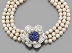 A diamond, sapphire, cultured pearl, platinum and 18K gold necklace.