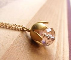 Baby Flower Necklace . swarovski crystal and gold bead cap . gold filled chain by CocoroJewelry on Etsy