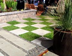 San Francisco Flower & Garden Show- concrete path filled with pebbles and the raised planter