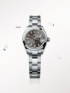 The Rolex Lady-Datejust 28 in steel, with a dark grey dial and Oyster bracelet.