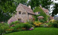 beautiful ivy covered stone cottage.  home and gardens are gorgeous!