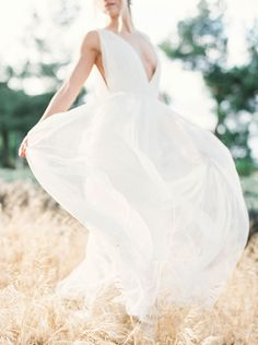 gorgeous gown with plunging neckline |   Photography: Sally Pinera - sallypinera.com Wedding Gown: Alexandra Grecco - www.alexandragrecco.com/