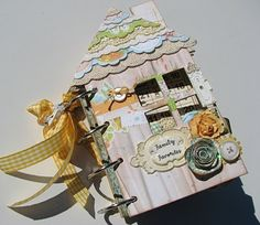 Adorable house-shaped mini album by dolcescrapbook.blogspot.com.  She has such a nice style.  The colors she used on this are fab.