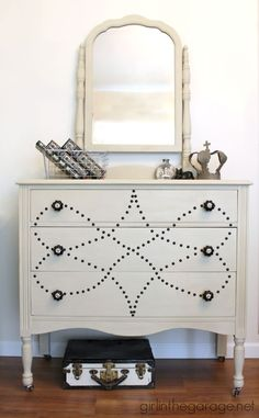 See how a dated vanity is transformed with Chalk Paint and a custom nailhead upholstery tack design. (As published in Better Homes and Gardens magazine!) DIY painted furniture makeover ideas by Girl in the Garage Old Dresser Makeovers, Diy Dresser Makeover, Old Dressers, Furniture Makeover, Dresser Ideas, Girl Makeover, Chair Makeover, Dresser Drawers, Paint Furniture