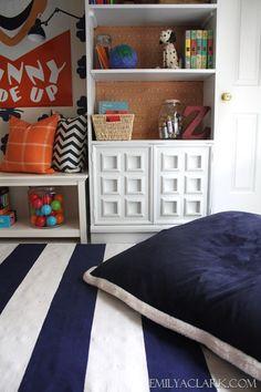 Pottery Barn Kids floor pillow & striped mat Love the cabinet doors