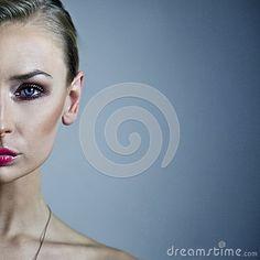 Half face portrait of blonde beauty.