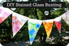 Stained Glass Bunting. I would love to hang this outside, but really wonder if the hot summer sun would remelt it.