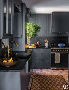 Step Inside Seth Meyers's Manhattan Duplex The kitchen walls and cabinetry are painted in Farrow Balls offblack. Home Decor Kitchen, Interior Design Kitchen, New Kitchen, Kitchen Dining, Kitchen Walls, Cozy Kitchen, Decorating Kitchen, Awesome Kitchen, Updated Kitchen