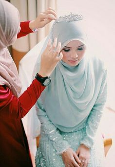 Bride getting ready.....wedding outfit by Ejashahril.