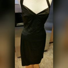 PAPELL Boutique evening black dress Beautiful black evening dress. 66%Acetate ---30%Nylon __4%Spandex lining size 6 Dry clean  only. A strap around the neck. Please feel free to ask questions before purchasing. Thank you for shopping my closet! Dresses Prom