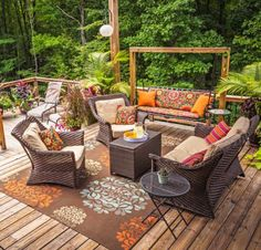 Make your deck super-inviting with wicker furniture and comfortable cushions. More deck and patio ideas: http://www.midwestliving.com/homes/outdoor-living/30-ideas-to-dress-up-your-deck/