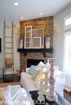 I love the antique windows on the mantel....seriously, LOVE