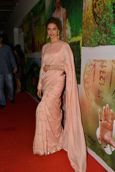 Deepika Padukone was beautiful in a peach Payal Singhal sari with red lips and an updo at the screening of 'Finding Fanny'