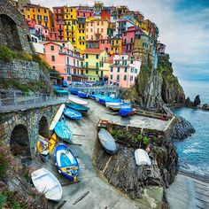 """Cinque Terre means """"Five Lands"""" and it is a cluster of five tiny towns on the western coast of Italy. I arrived in Manarola and was immediately blow away by the lively colors of the homes...."""