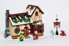 Hello everybody! I'm here to present my entry to this year's Expand the Winter Village Contest, the Winter Village Sweet Shoppe!  On the outside we have lig...