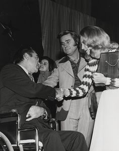 Governor George Wallace of Alabama greets Tammy Wynette & George Jones.