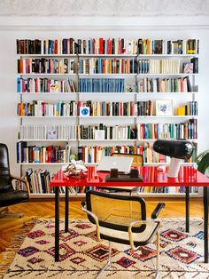 Black-framed Cesca armchairs, red lacquer desk, Snoopy lamp.