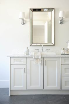 #bathroom, #cabinet, #sconces, #white, #mirror Photography: Tracey Ayton - traceyaytonphotography.com Read More: http://www.stylemepretty.com/living/2014/03/24/the-doctors-closet-home-tour/