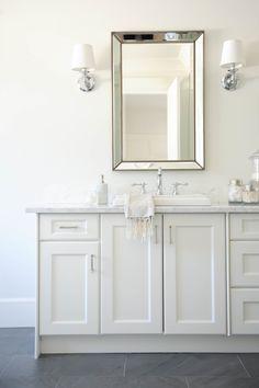 Serene white bathroom with gray slate floors