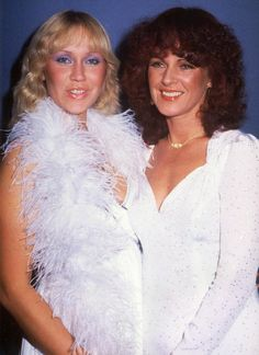 Agnetha and Frida pose together in one of the many Super Trouper photo shoots, in 1980