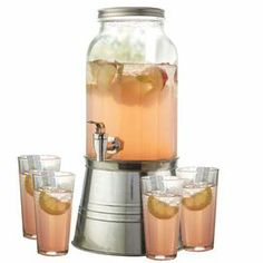 """Showcasing a bucket-inspired base and jar design, this essential beverage dispenser includes 4 glasses for serving guests at your next backyard soiree.  Product: 1 Beverage dispenser and 4 cups Construction Material: Glass and metalColor: ClearFeatures:  Beverage dispenser has 2.2 Gallon capacityCups have four ounce capacity Bucket-inspired baseSpout for easy pouringDimensions: 20"""" H x 11"""" Diameter (beverage dispenser)Note: For cold beverages only"""