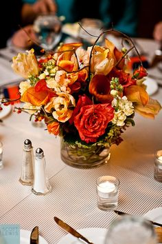 Beautiful Blooms - Warm Orange Centerpiece with Branch Accents