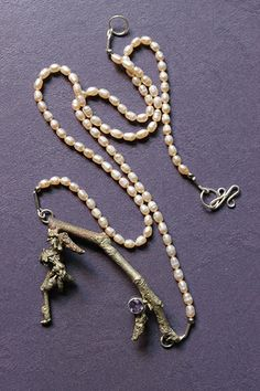 Rosebud necklace by Hunt Design Jewelry. Keep spring eternal with this beautiful freshwater pearl and bronze redbud branch necklace. Carefully placed on the branch is an amethyst, the color of the redbud flower. Hand cast with hand forged findings. American Made. See the designer's work at the 2015 American Made Show, Washington DC. January 16-19, 2015. americanmadeshow.com #necklace, #jewelry, #freshwaterpearl, #bronze, #redbud, #amethyst, #americanmade