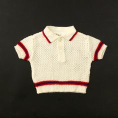 "OH dear! Amazing 70's does 50's crochet baby polo-shirt.Absolutely adorable!This polo comes in a good vintage condition.Size: tag says; Age 1 size 74.  Would approximately fit best to a 6 to 9 months old. To be sure, please check measurements taken below.  Shoulder to Hem: 27cm (10,5"")Shoulder to shoulder: 26cm (10,5"")Armpit to armpit: 28cm (11"")"