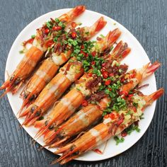 Steamed Prawn with Spicy XO Sauce, Garlic, Ginger, Chilies and Chinese Sausage. A classic Chinese Indonesian style steamed dish.