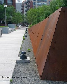 Corten steel retaining wall. Pinned to Garden Design - Walls, Fences & Screens by Darin Bradbury.