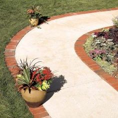 Make an attractive border for a concrete walkway or patio using brick pavers set. Now I like the border of brick. With a solid gravel base, a brick border will last for the life of your house. . . . I wonder if you can do this with stone?