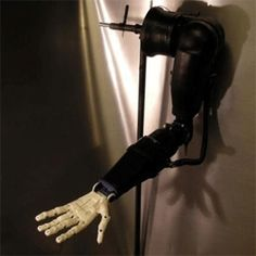 Teen develops brain-controlled 3D printed prosthetic arm.