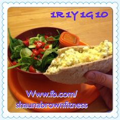 21 day fix lunch! Egg salad (one egg and 1/2 red cottage cheese mixed with some mustard and relish) stuffed into whole wheat pita. Served with large green salad with cucumbers/peppers/tomatoes and 1 orange salad dressing