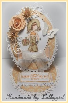 A card nade using grand oval nesties for the base,a sarah kay stamp,promarkers,J'adore first edition papers,tonic rose punch set ,memory box rolled flower and flourish dies and an su sentiment stamp