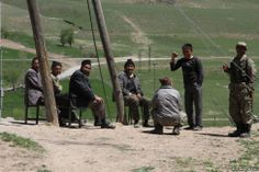 Men relax outside in the village. The Turkish government sends mullahs to teach the Kyrgyz the tenets of Islam, but they otherwise have little contact with their neighbors in the region, who are ethnic Kurds.