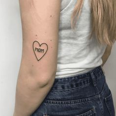 Mother daughter tattoos are extremely popular. Here are some tattoo ideas for matching tattoos moms and daughters can get done to celebrate their love, as well as classic mom tattoos for daughters and sons to dedicate to their moms on Mother's Day. Mom Heart Tattoo, Mum Tattoo, Mom Dad Tattoos, Neck Tatto, Mother Daughter Tattoos, Tattoos For Daughters, Wrist Tattoo, Tattoos For Moms, Tiger Tattoo